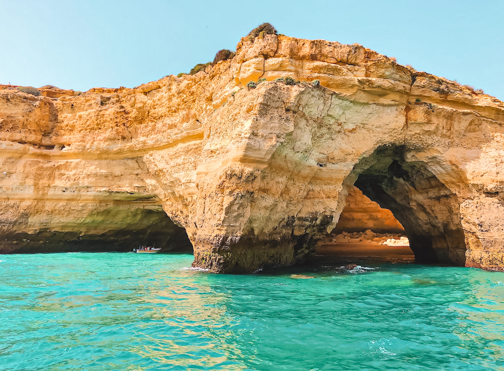 Beach hidden by sea arch