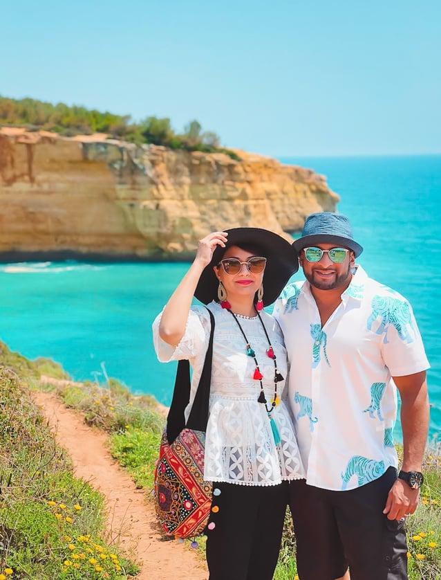 Muslim travel couple on beach cliffs