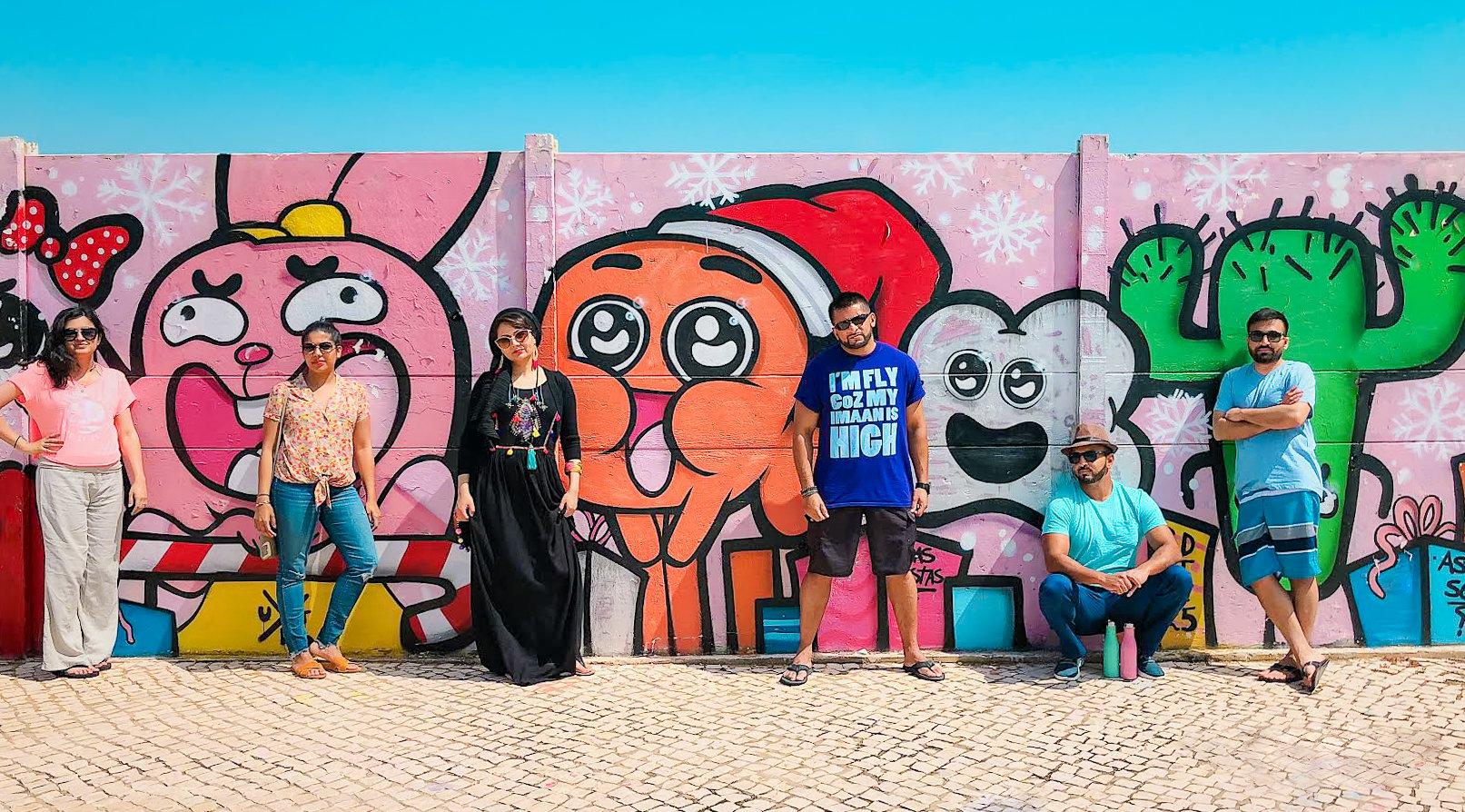 Muslim friends with graffiti wall in Algarve