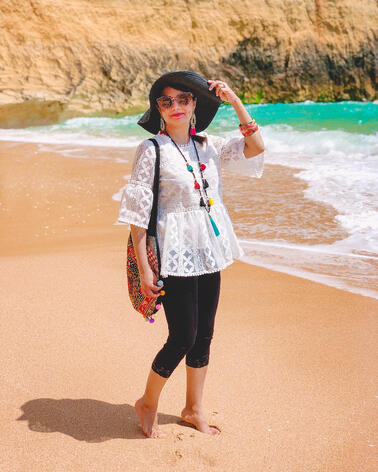 Muslim travel blogger on sandy beach