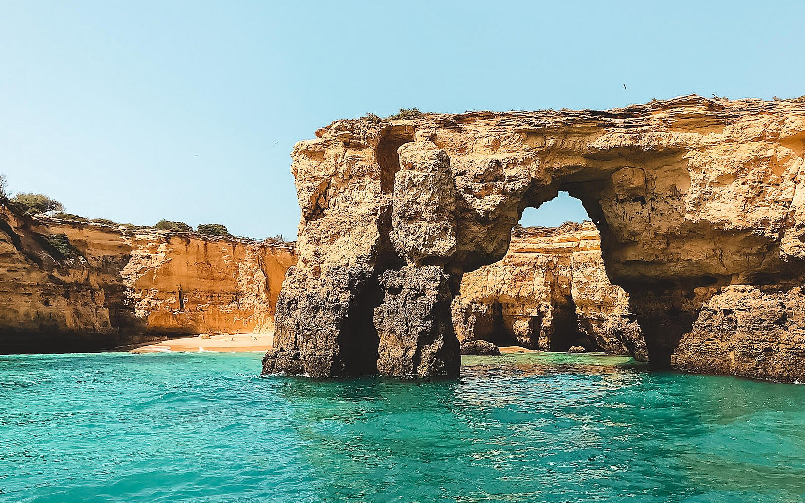 Sea arch surrounded by blue water