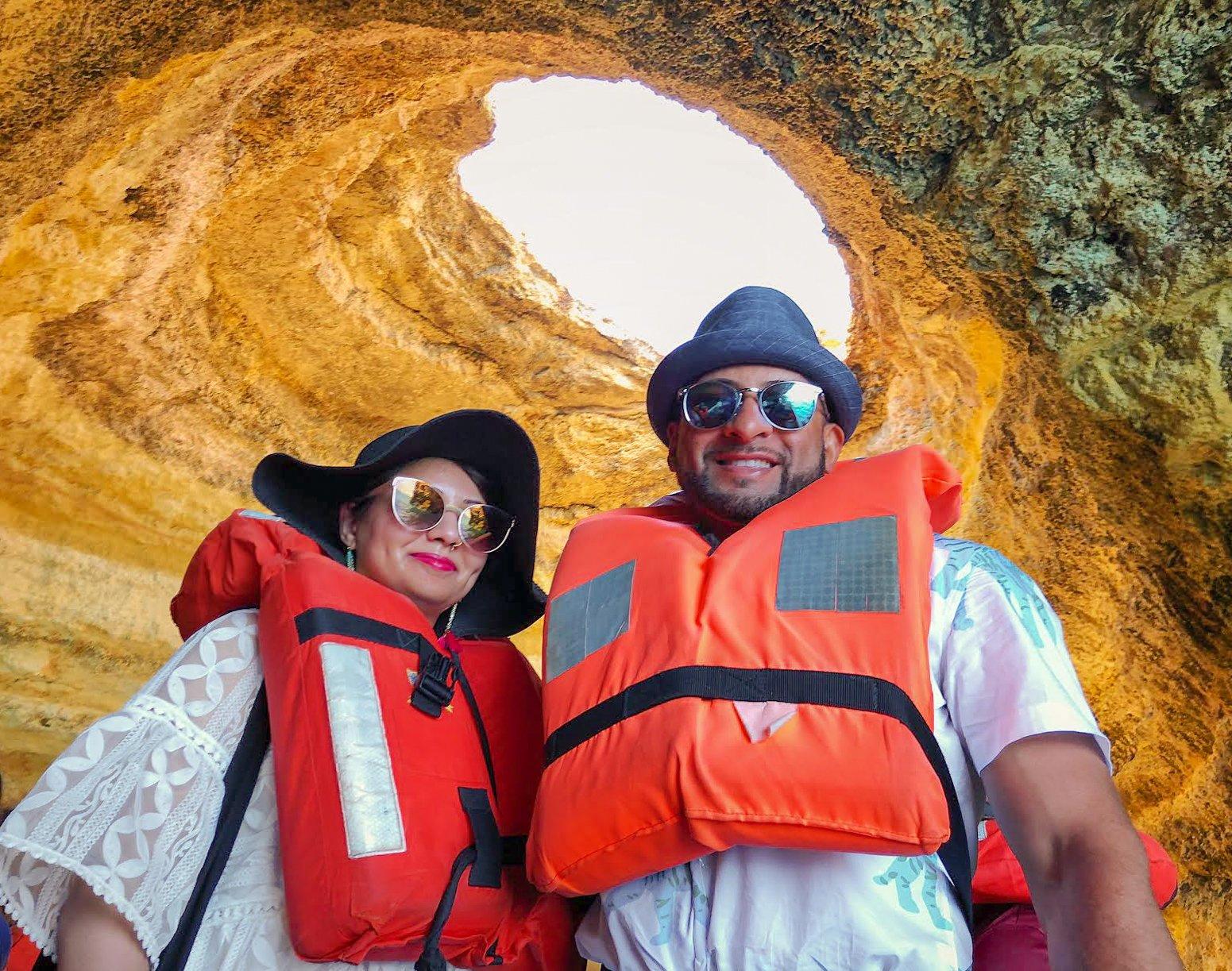 Muslim couple wearing life jackets in Benagil cave