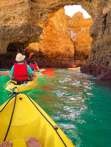 Muslim friends kayaking in Lagos through caves