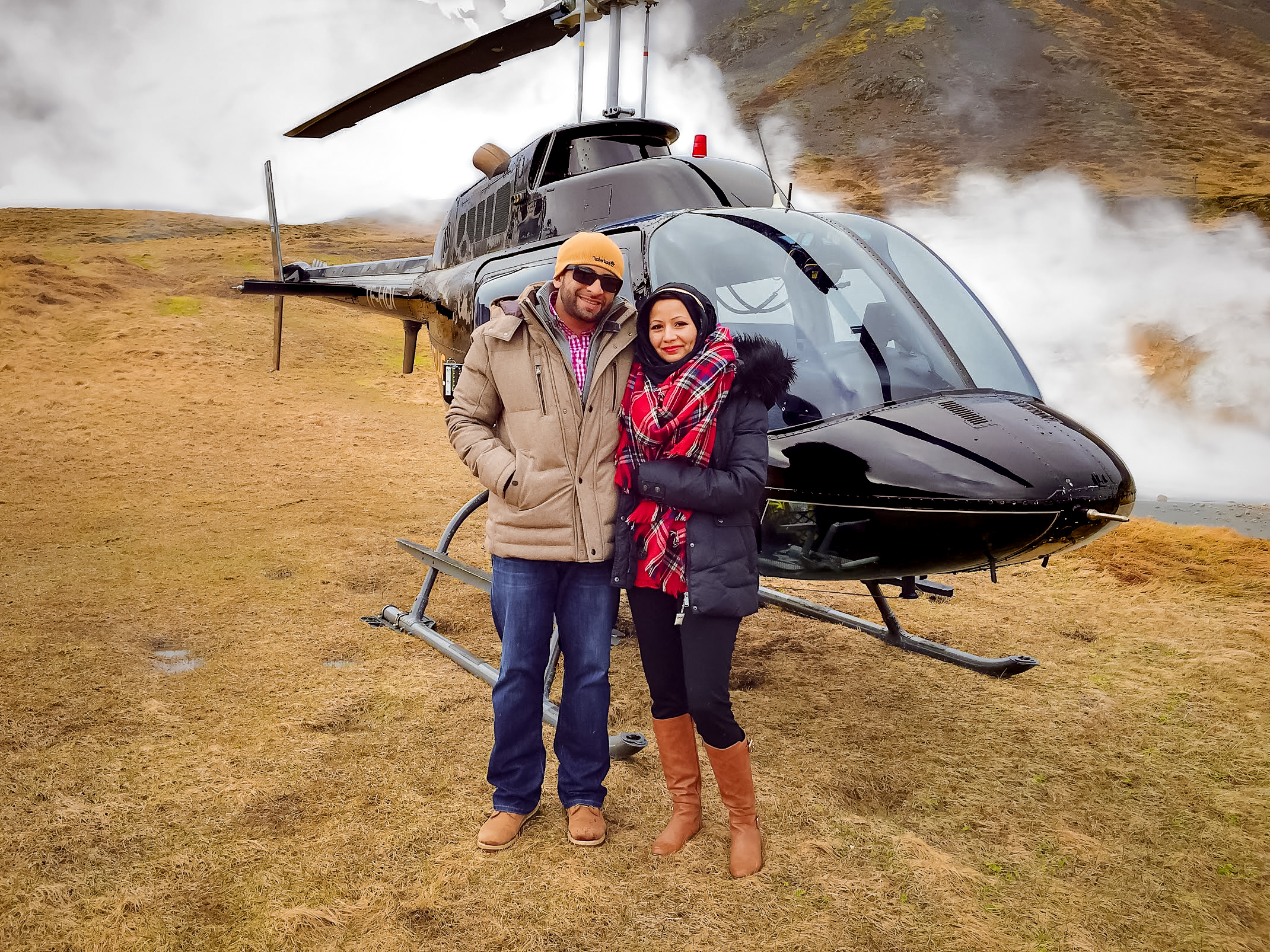 muslim travelers on volcano with black helicopter