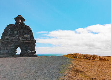 Sculpture of rocks near ocean