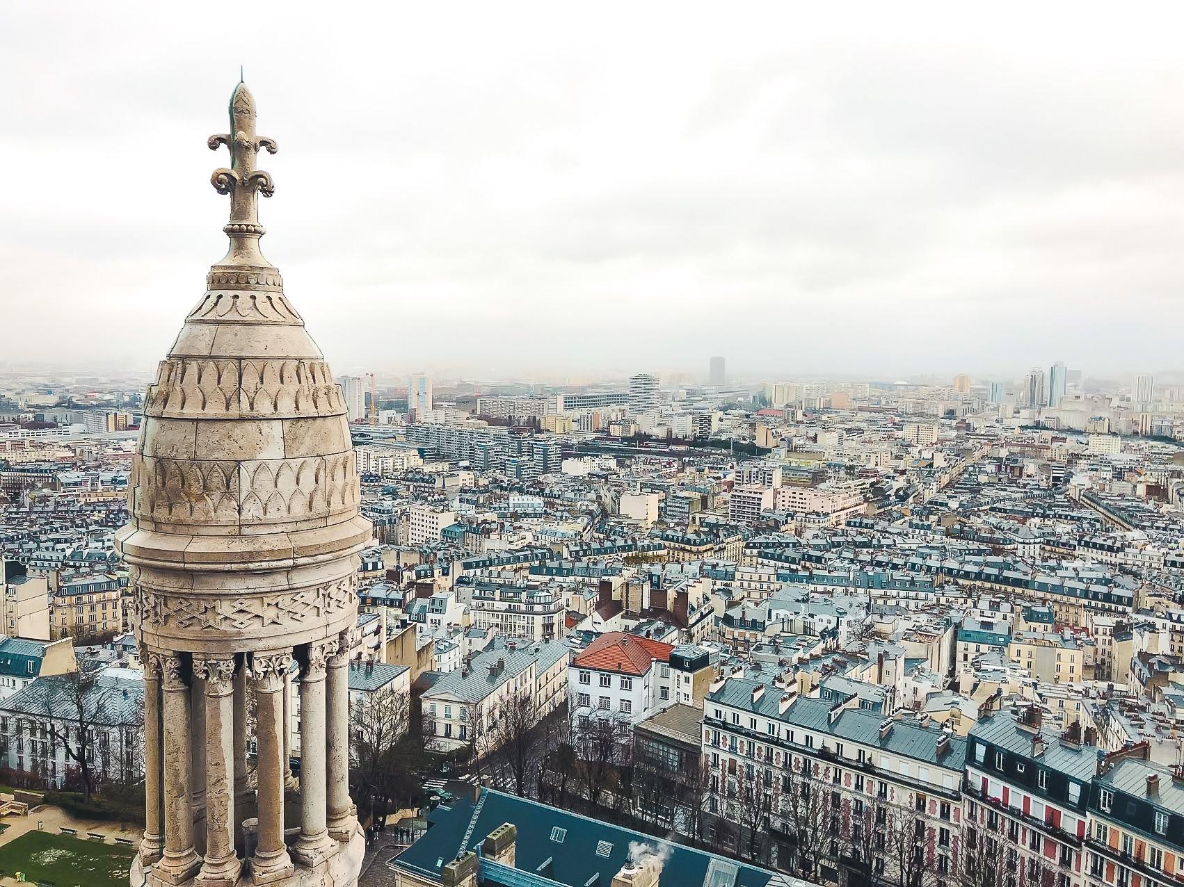 White dome of Sacré-Cœur Basilica and Parisian skyline