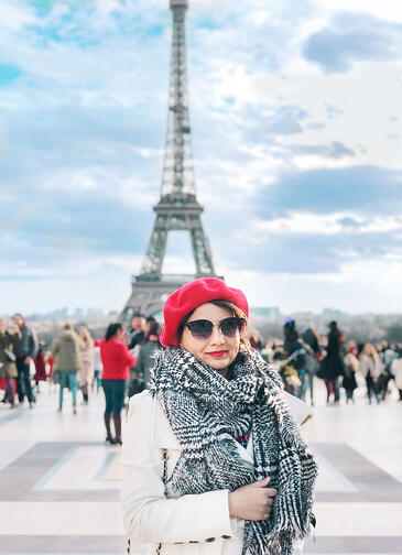 Muslim travel blogger with Eiffel Tower