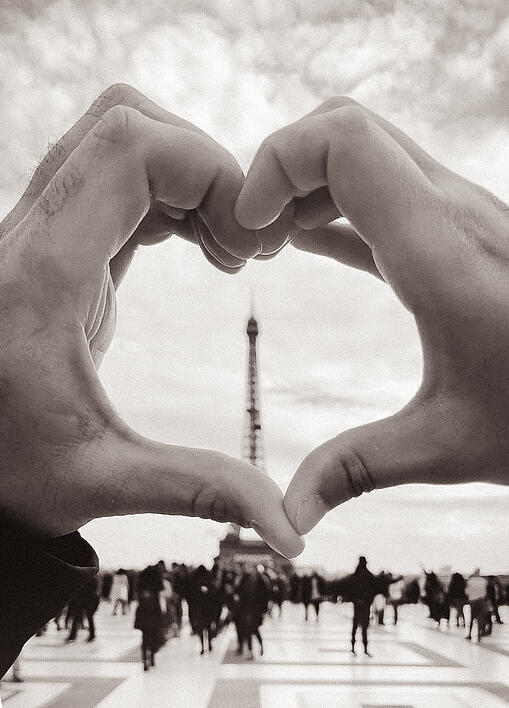 Hands making heart shape with Eiffel Tower