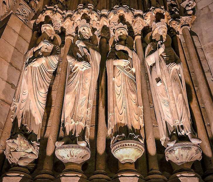 Sculptures of men on Notre-Dame facade