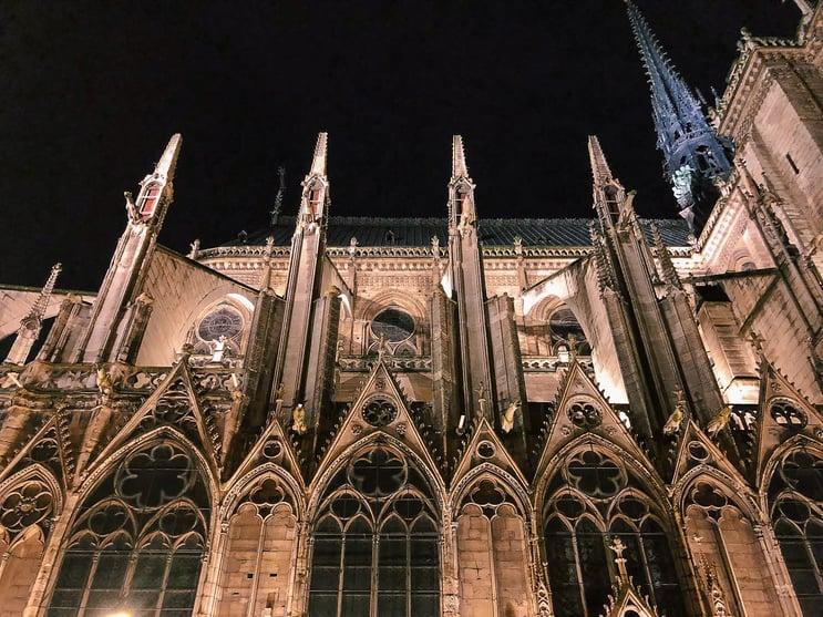 Gargoyles and blue spire of Notre-Dame in Paris