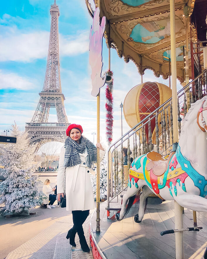 Muslim blogger on carousel with Eiffel Tower