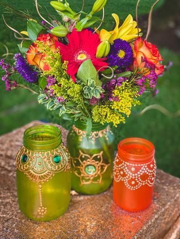 Eid-picnic-centerpiece-flowers-mehndi-mason-jars